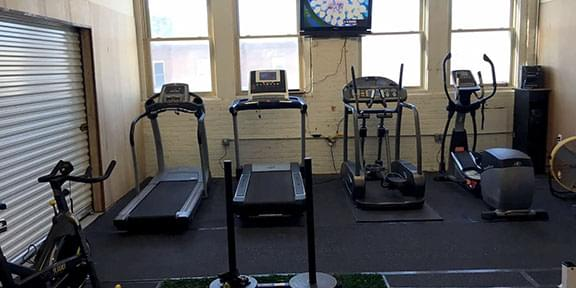 Various machines for indoor cardio workouts.